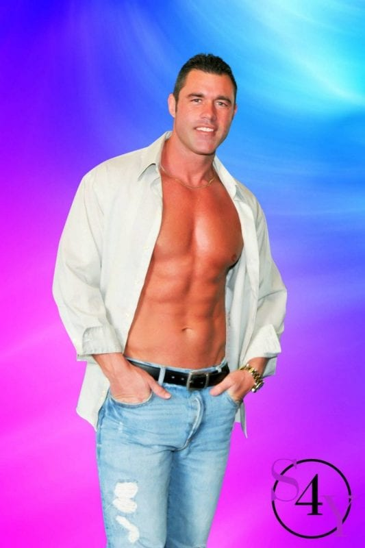 muscle male stripper in white dress shirt showing off abs