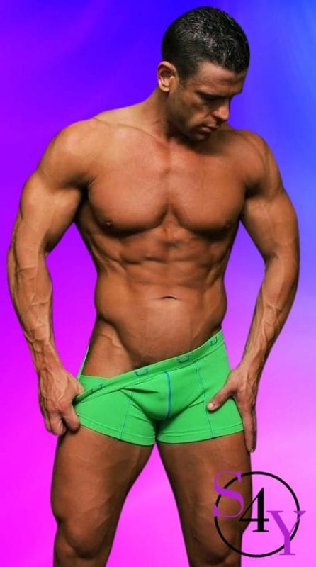 sexy bodybuilder taking off green briefs