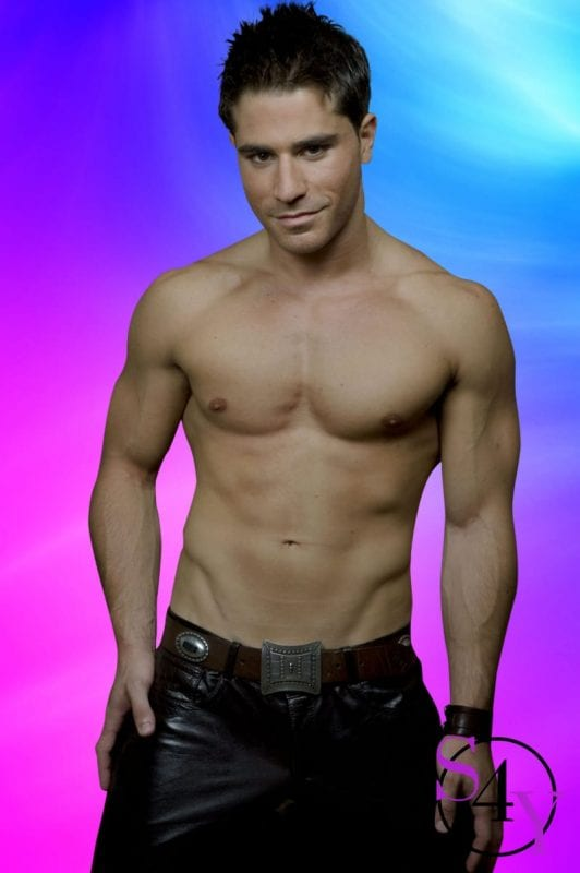 sexy male exotic dancer in black leather