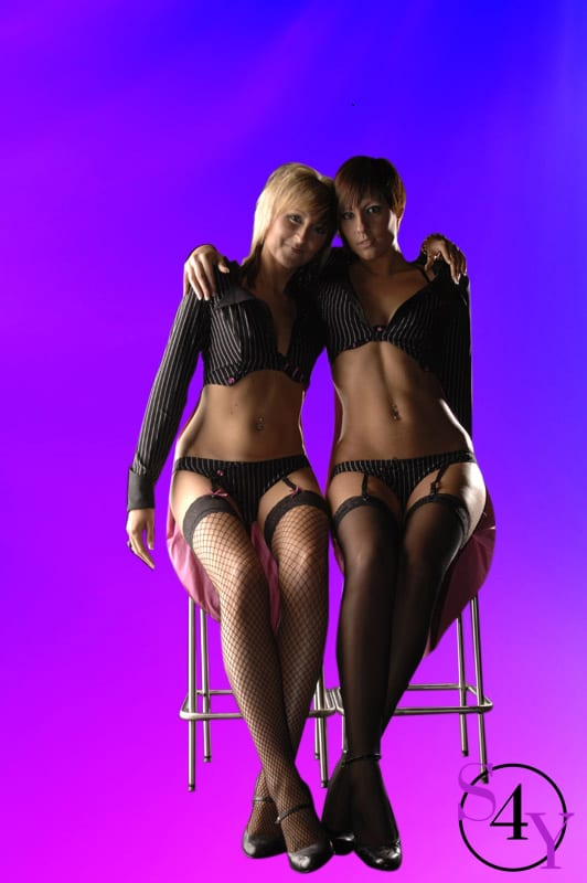 two sexy female strippers
