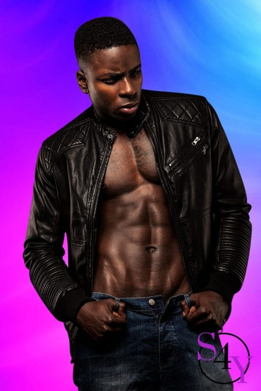 black male extoic dancer in leather jacket