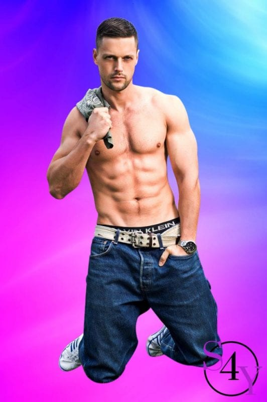 muscle male dancer in jeans showing off his abs
