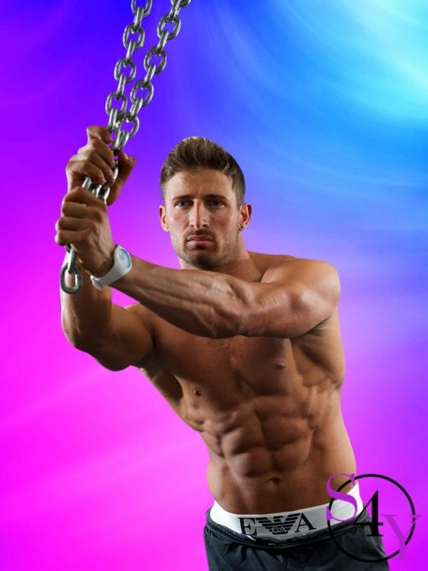 man showing off muscles holding on to chains