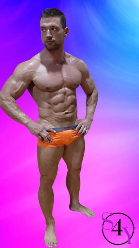 ripped male in orange briefs