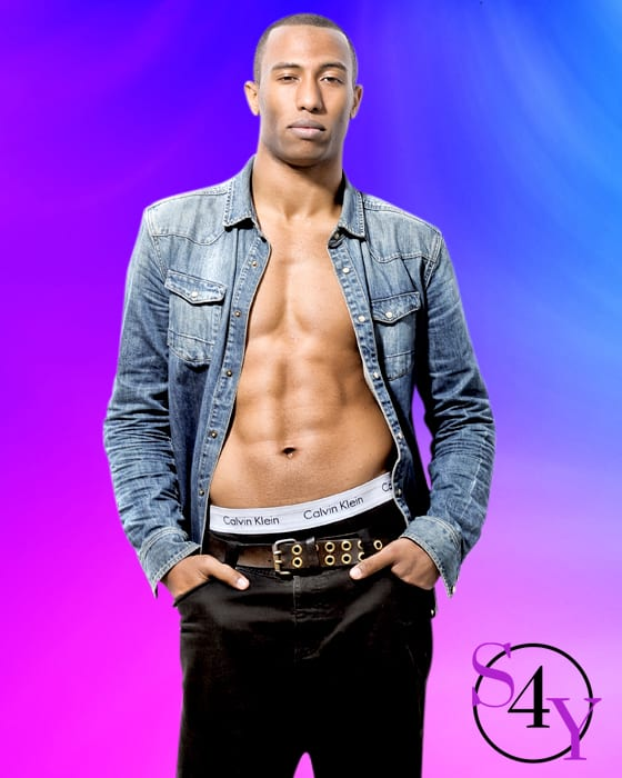 black male in jean jacket showing six pack