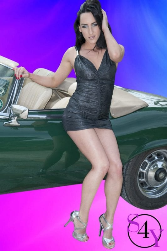 hot female leaning on a car