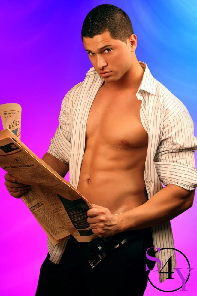 tan male stripper in black pants holding newspaper