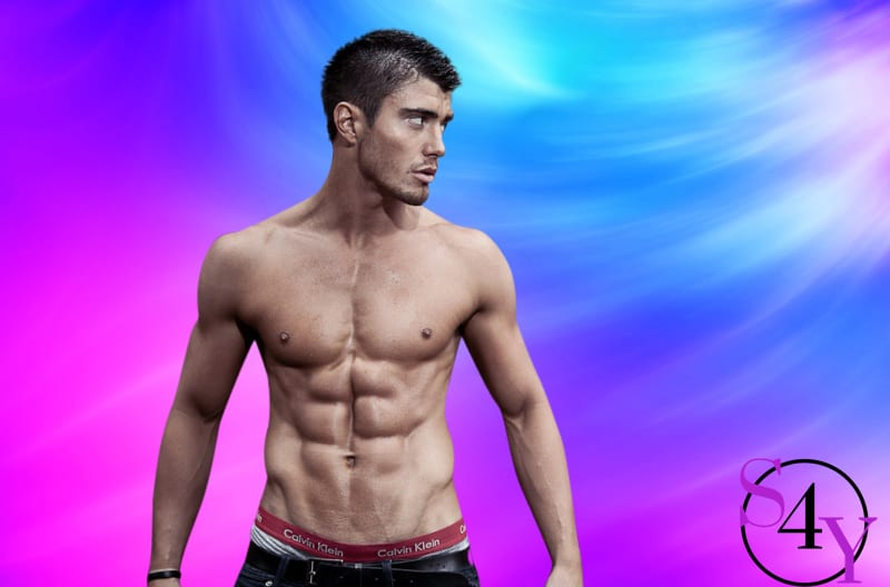 stunning muscular male showing off abs