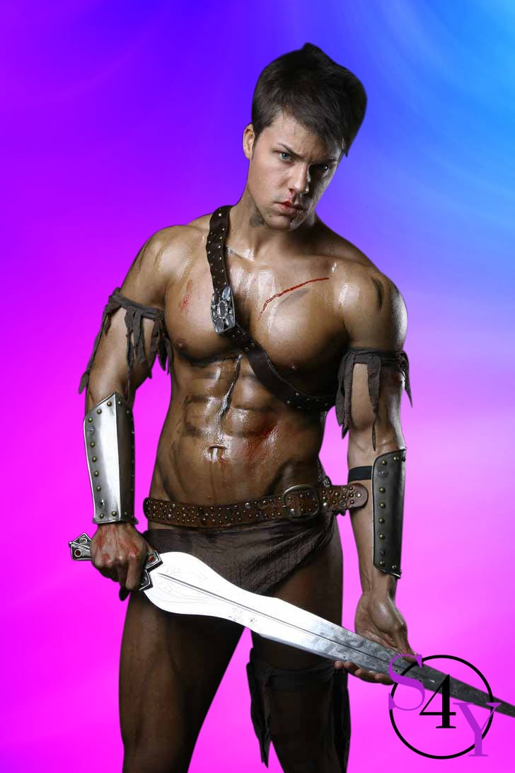 Muscular man wearing roman gear