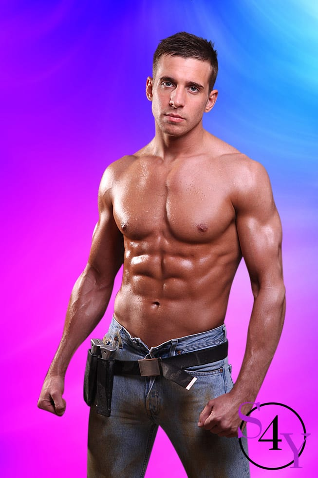 Tan white male with brown hair in jeans and construction belt