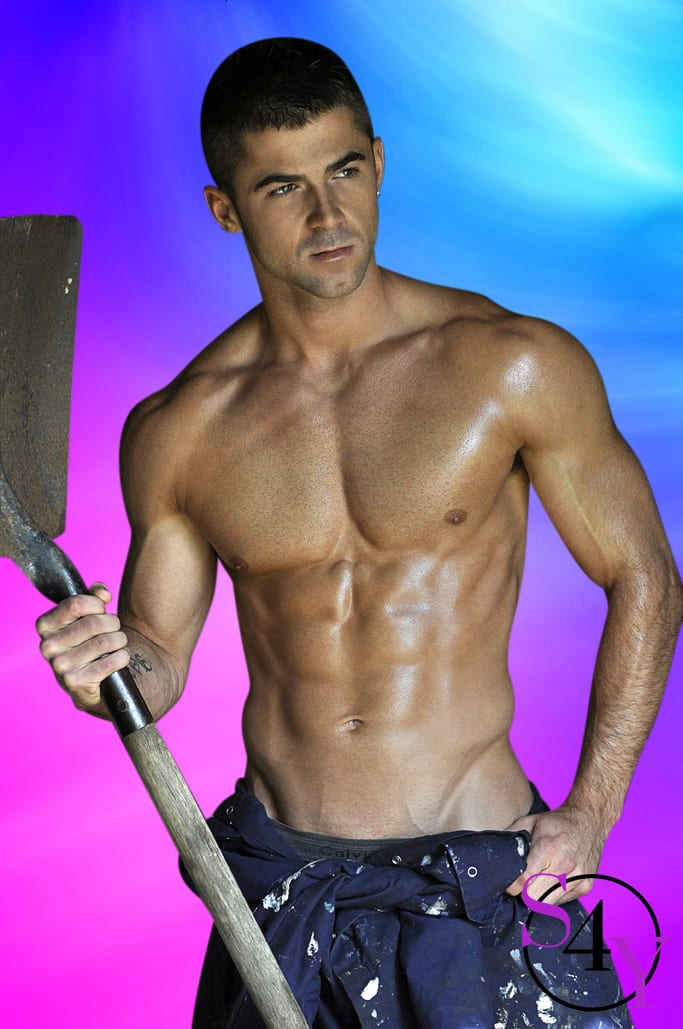Muscular Tan Male holding a shovel