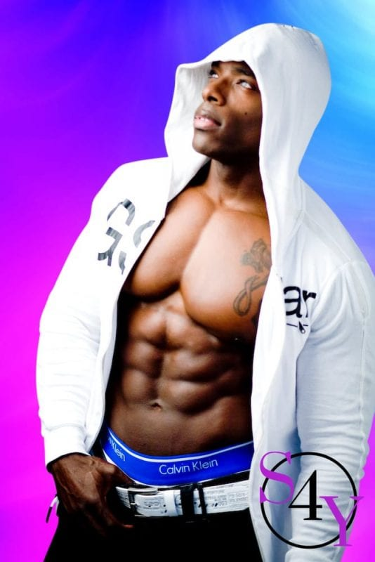 black man taking off white hoodie show his abs