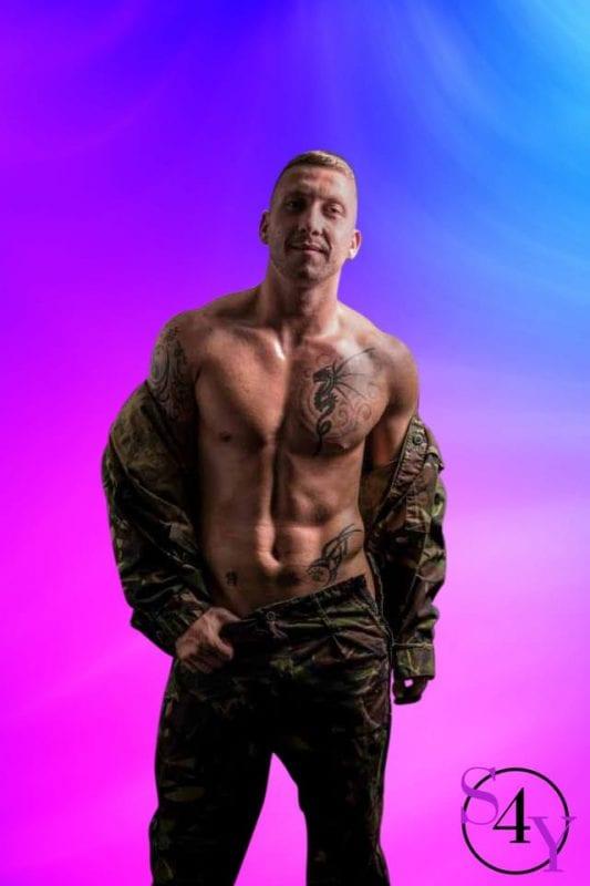 white male taking of jacket showing tattoos