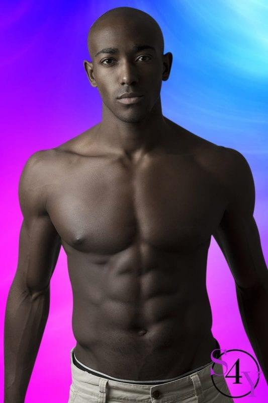 Black male exotic dancer in white shorts
