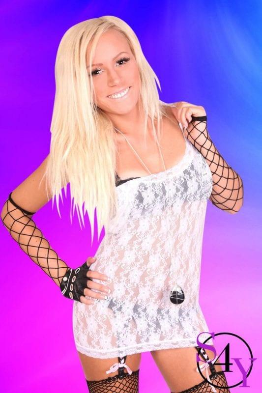 Hot blonde female stripper in white skirt