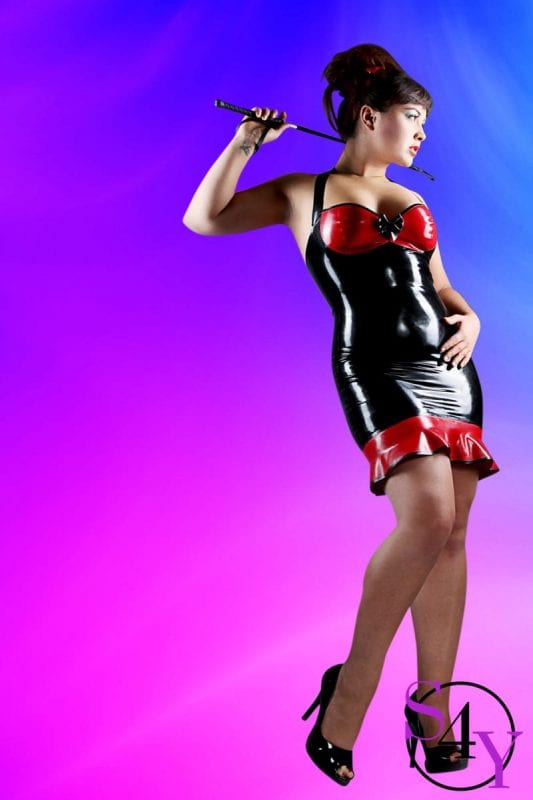 Hot Female in leather dress with whip