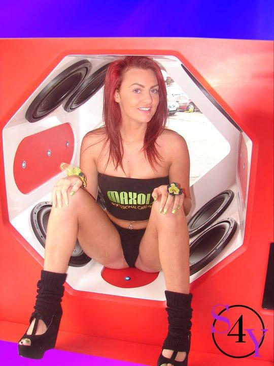 Sexy female stipper in red tube