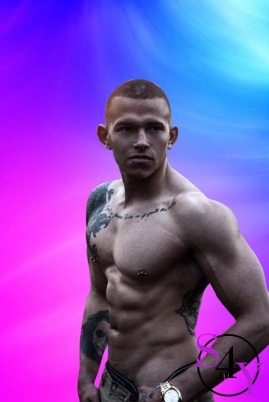 Black man with tattoos and no shirt