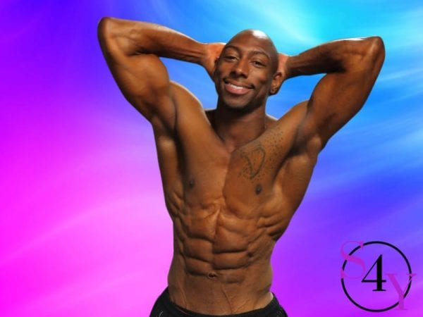 Sexy black male showing abs