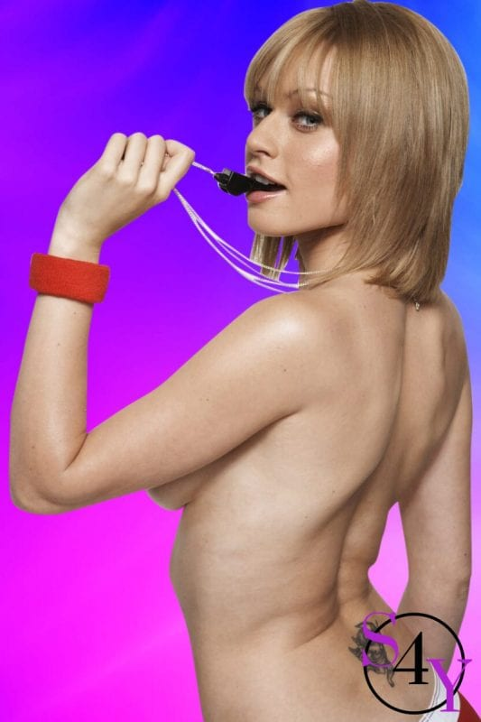 Topless female blowing whistle